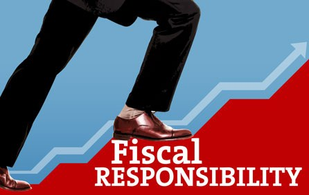 Shoes stepping on the words fiscal responsibility