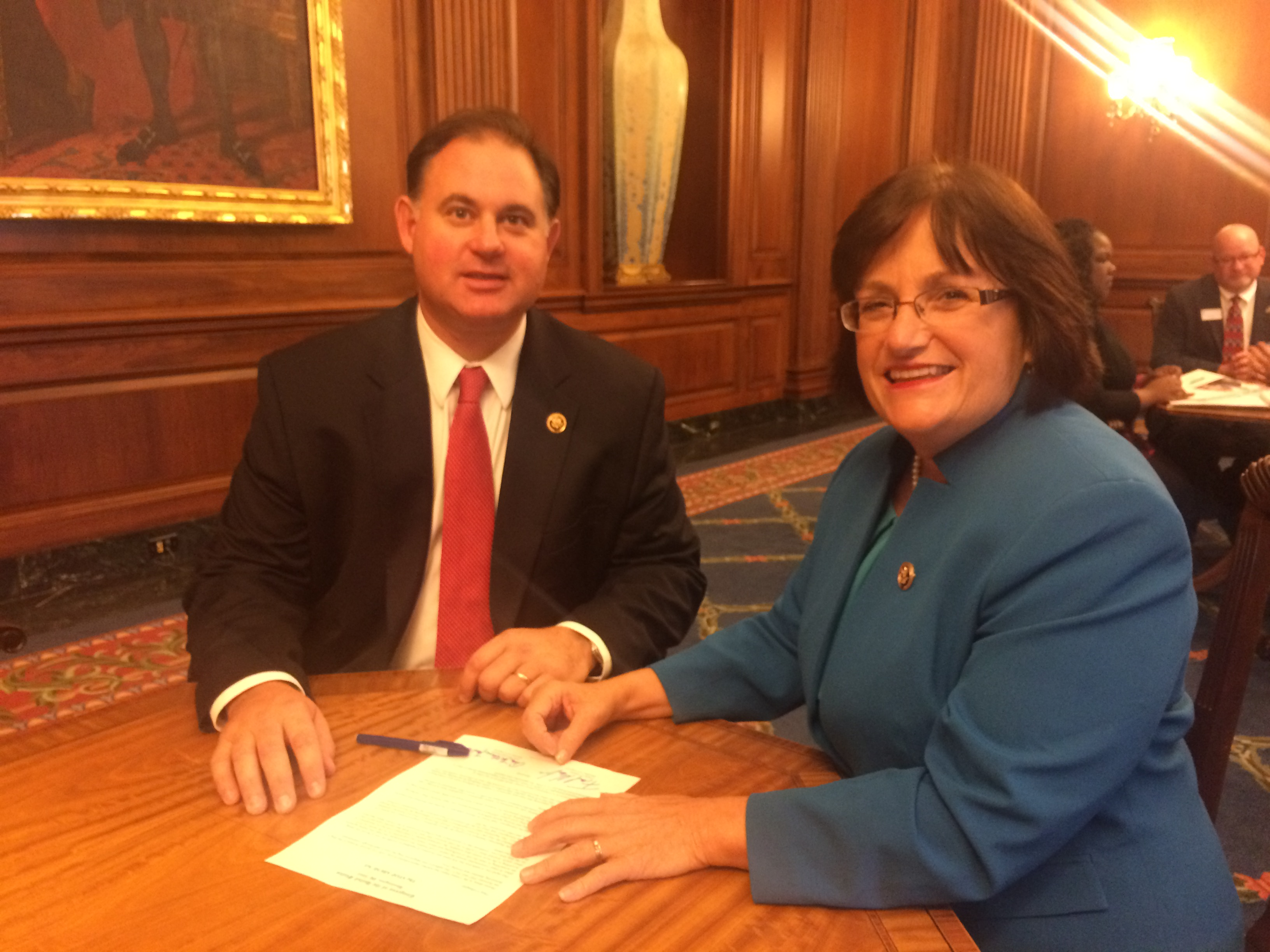 Reps. Kuster and Guinta after signing the STOP ABUSE Act.